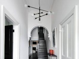 Curved ornate doorways with black floors