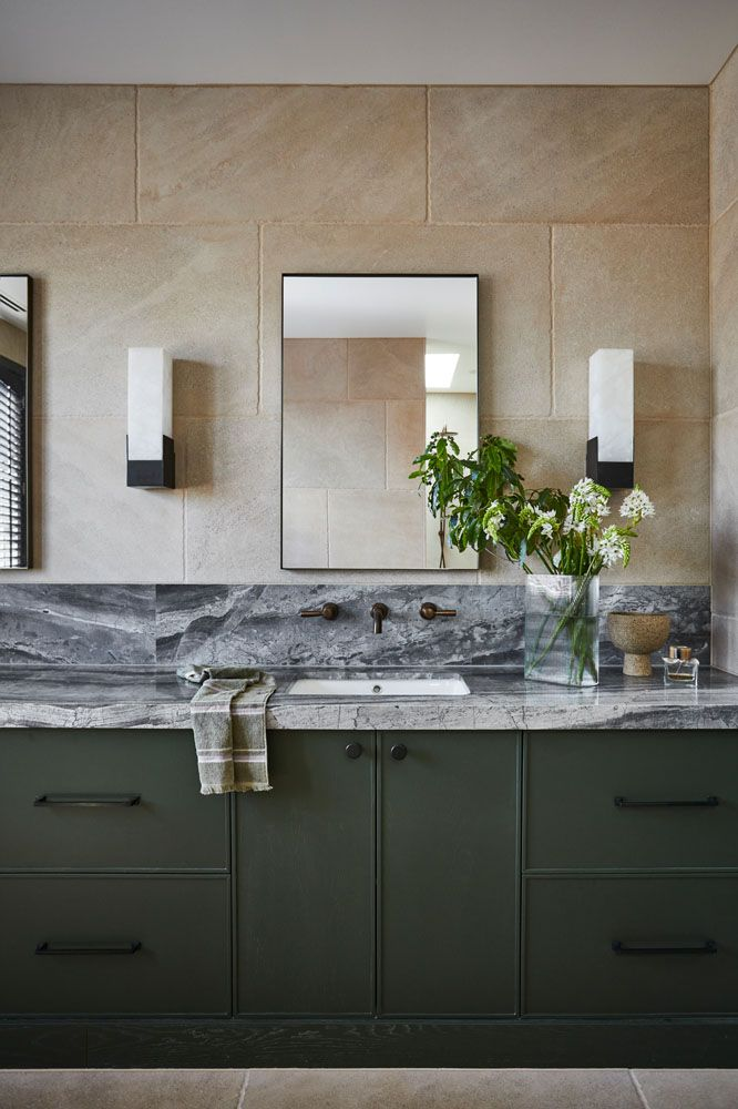 Dark green joinery in bathroom