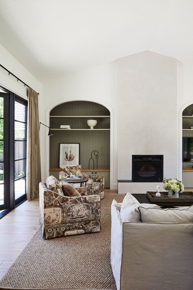 Recessed arch bookshelf with olive green shadow
