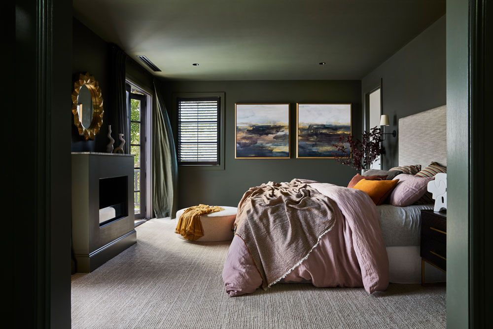 Moody dark green bedroom with dark green ceiling