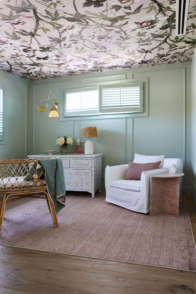 Girls bedroom with wallpaper ceiling