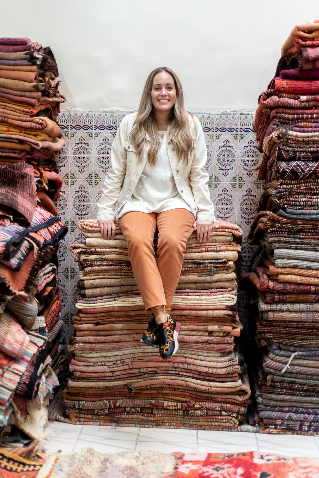 Stack of Moroccan textiles with Chantelle Traficante from Beni Kesh