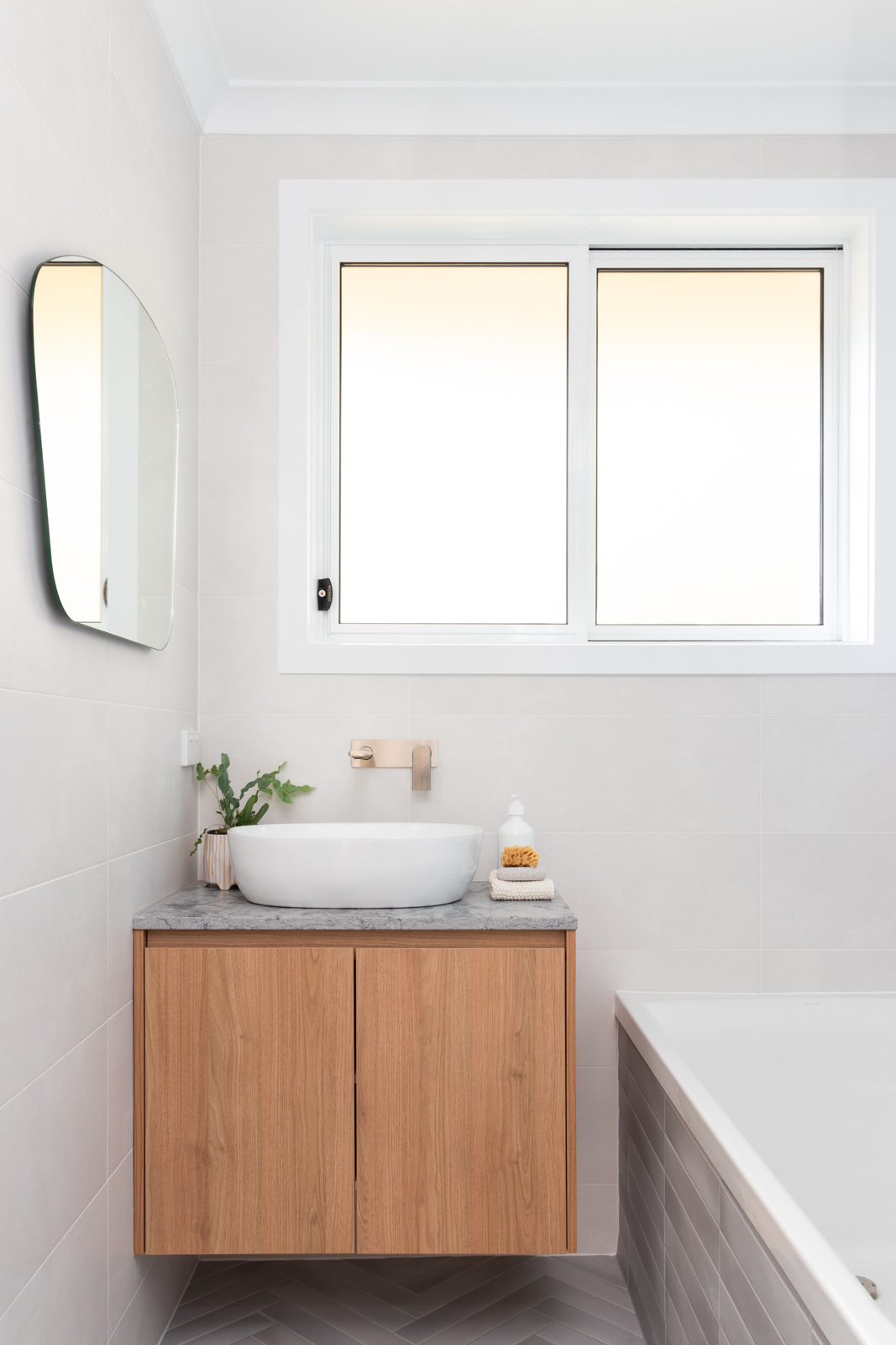 Timber vanity with organic shaped mirror