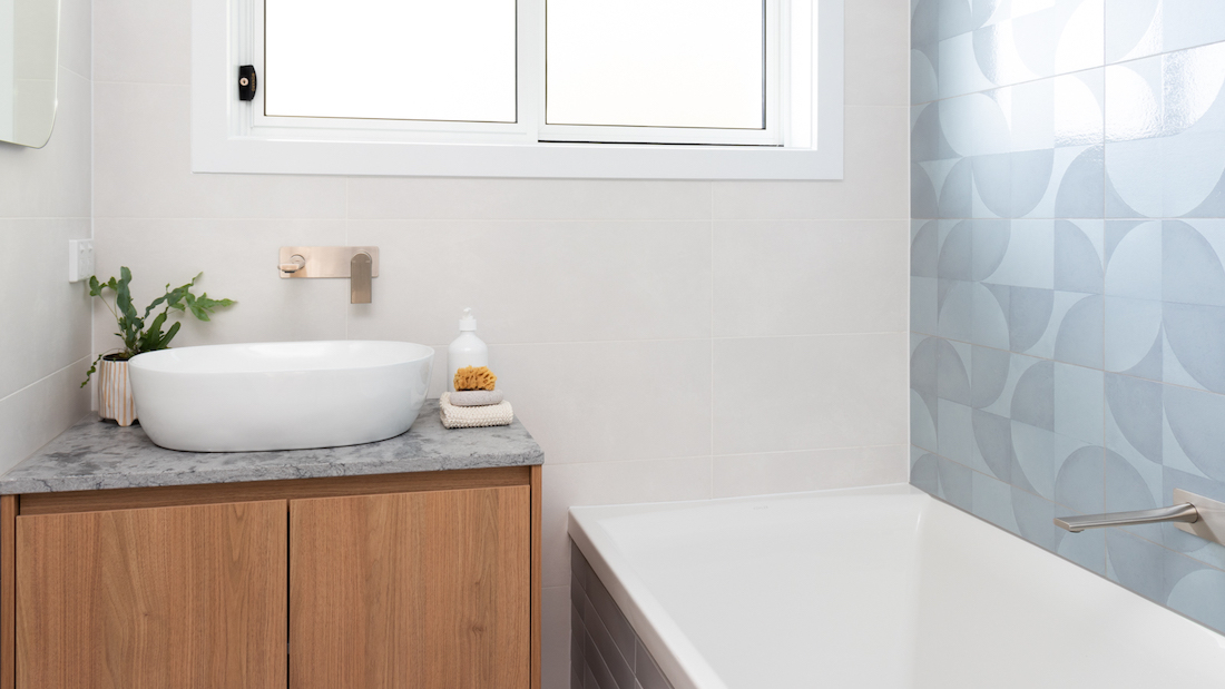Grey and white bathroom with mosaic tile