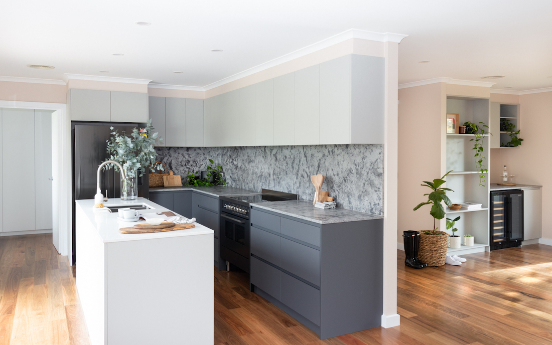 Grey kitchen with lounge and bar area