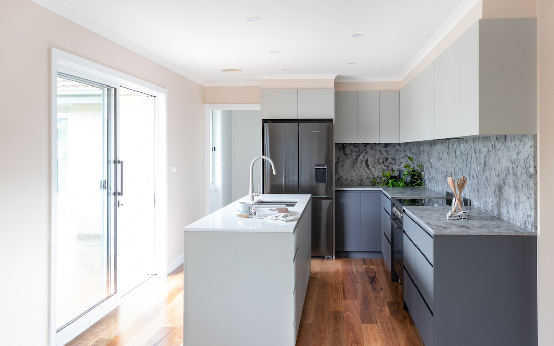 Grey and white kitchen with marble splashback