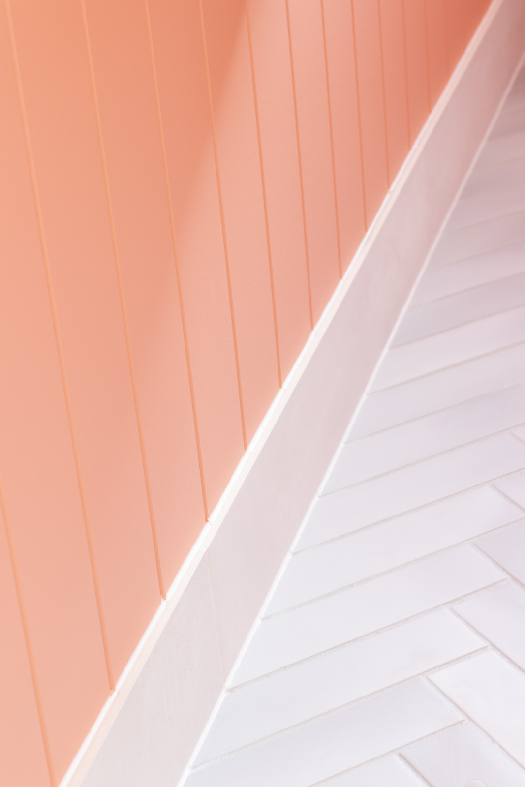 Pink walls and white floor tiles in bathroom