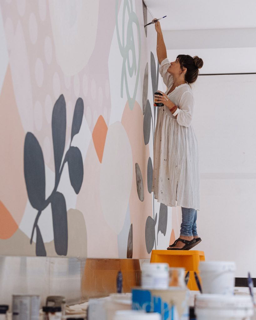 Kiasmin painting a mural