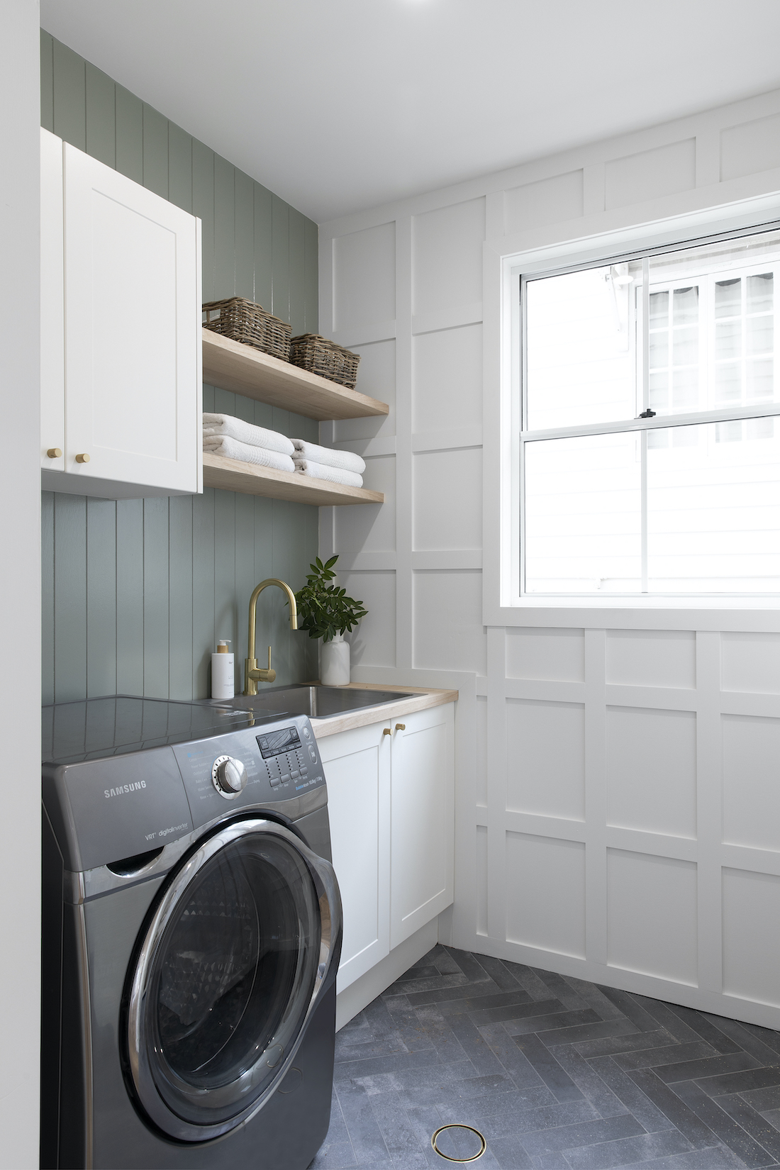 White wainscoat wall in laundry