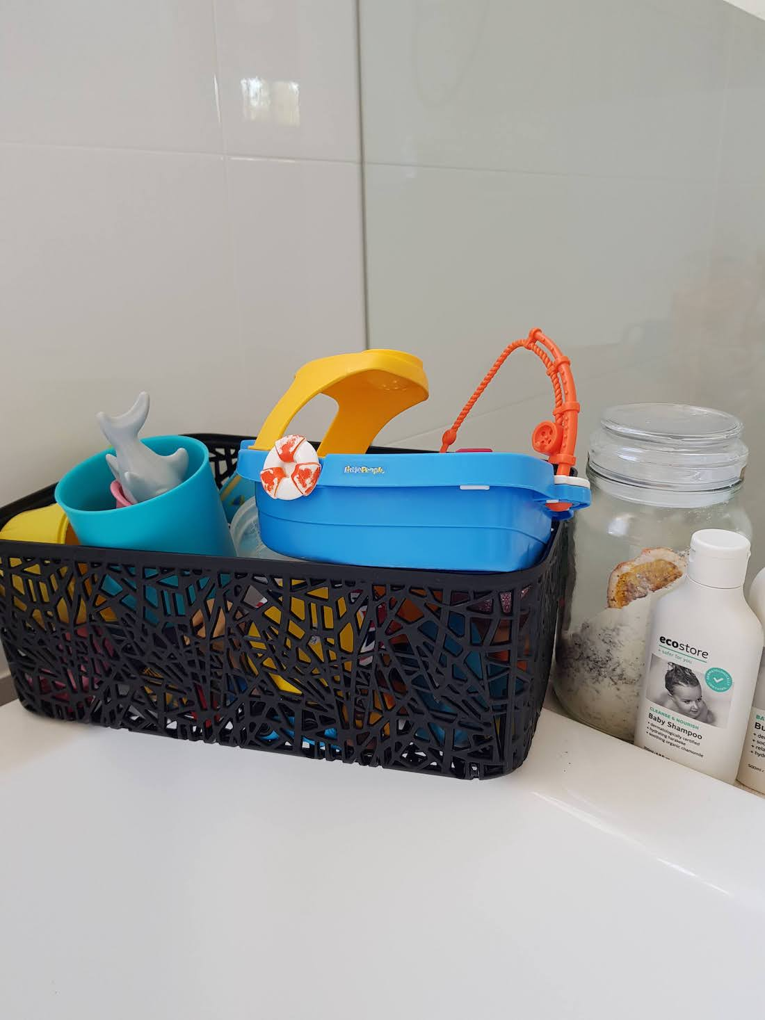 Bath toys stored in Kmart basket