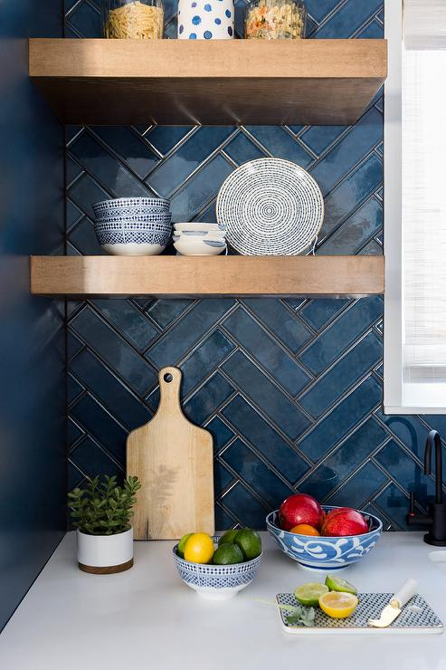 Dark blue herringbone tile