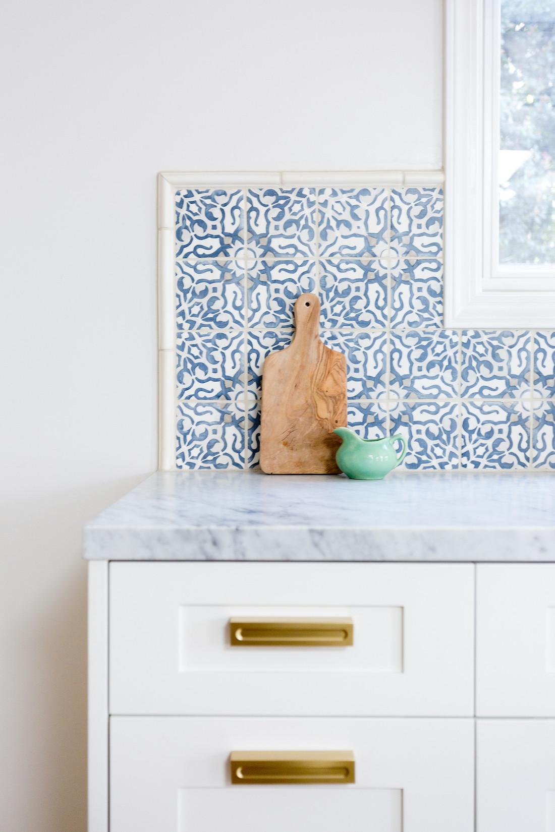 Finishing details around blue tile