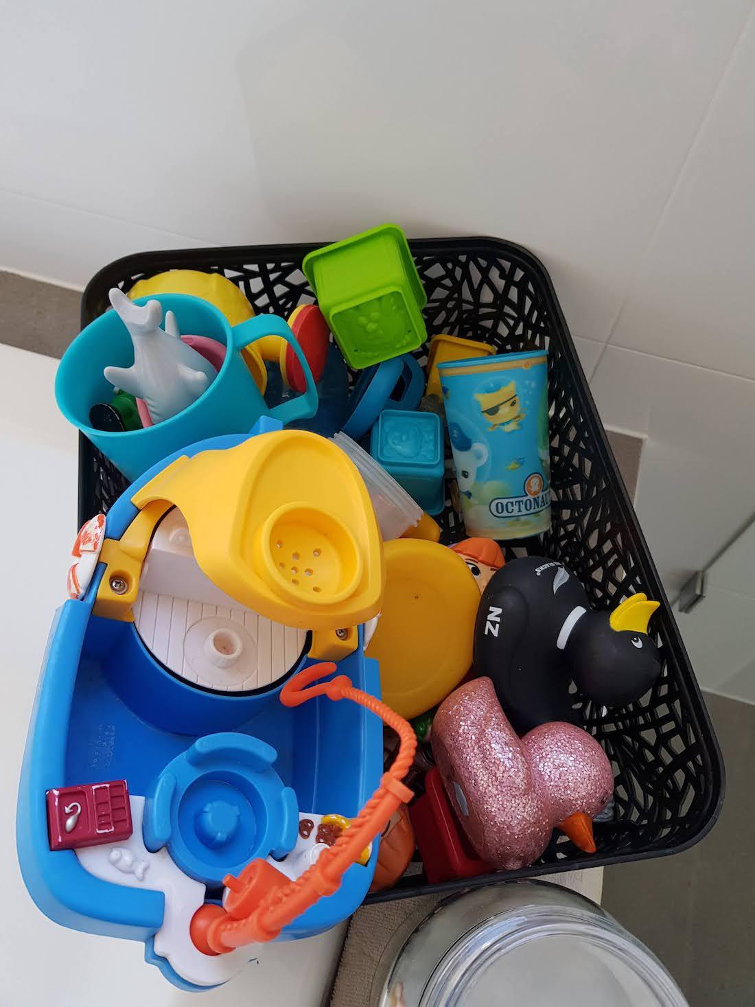 Black mosaic Kmart basket for toy storage