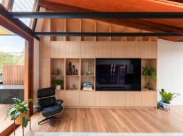 Living room cabinetry with Eames chair