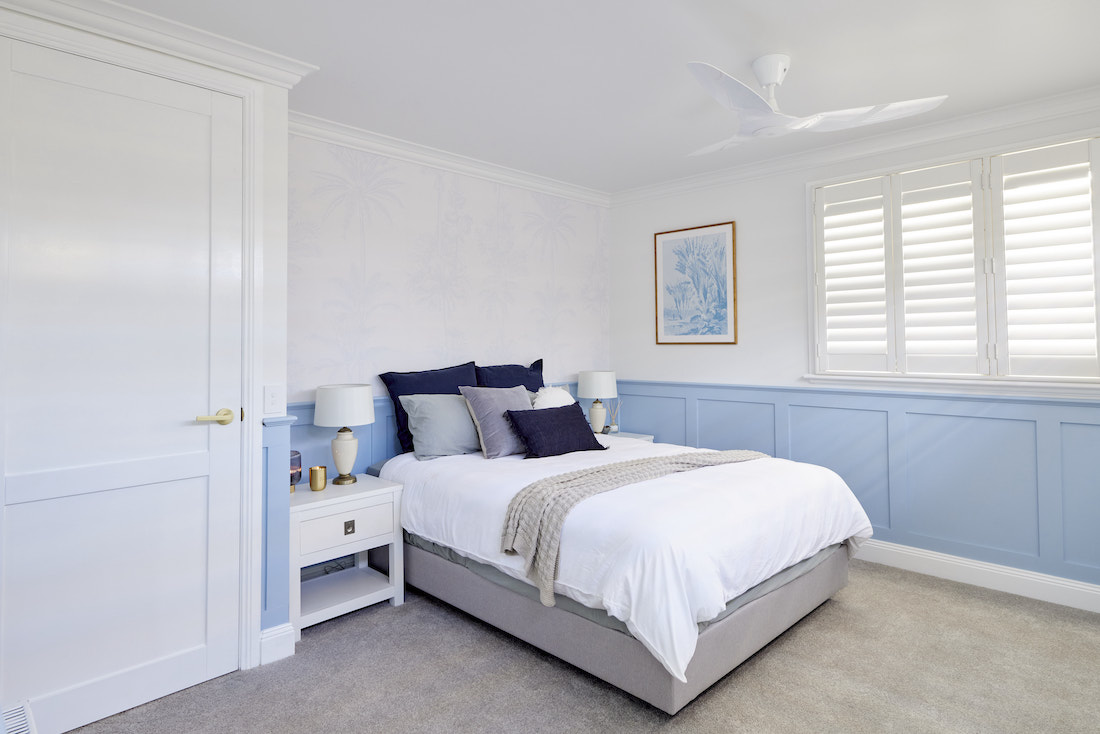 Hamptons style guest bedroom with plantation shutters