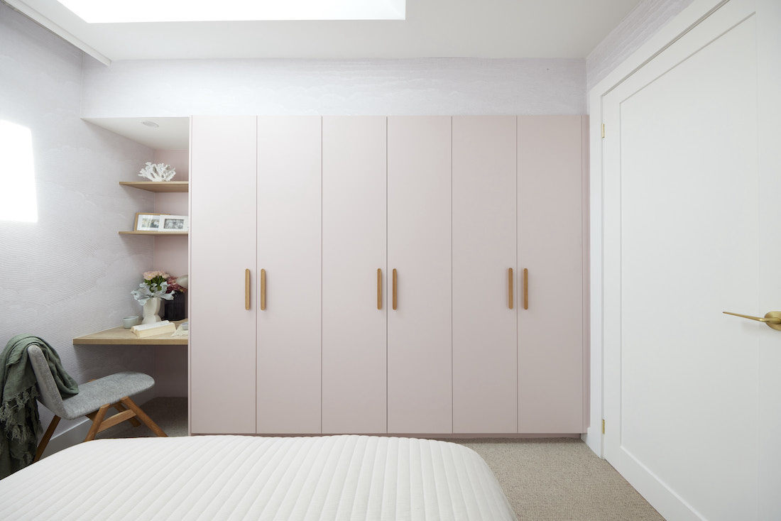 Guest bedroom with blush built in wardrobe