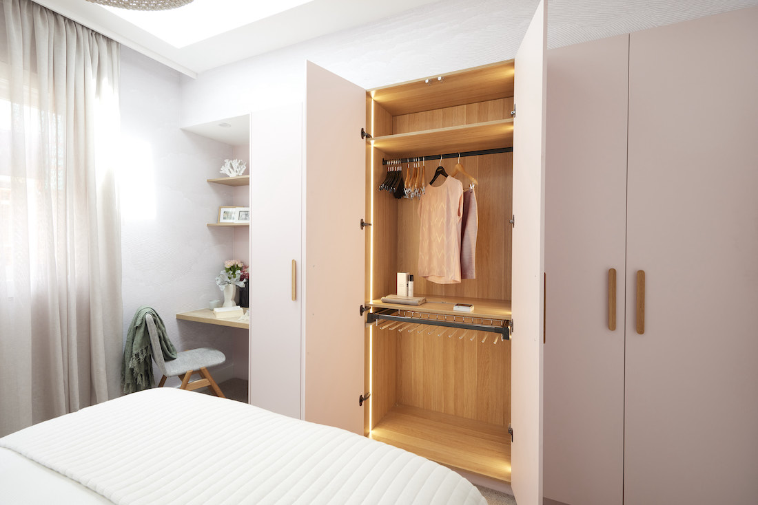 Guest bedroom with blush and timber wardrobe