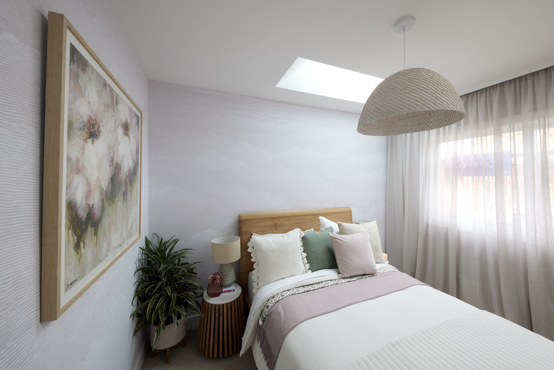 Blush and sage green guest bedroom