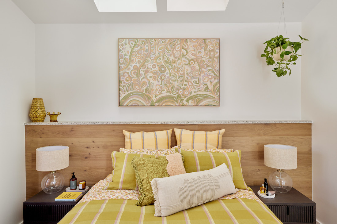 Green checked bedding in guest bedroom