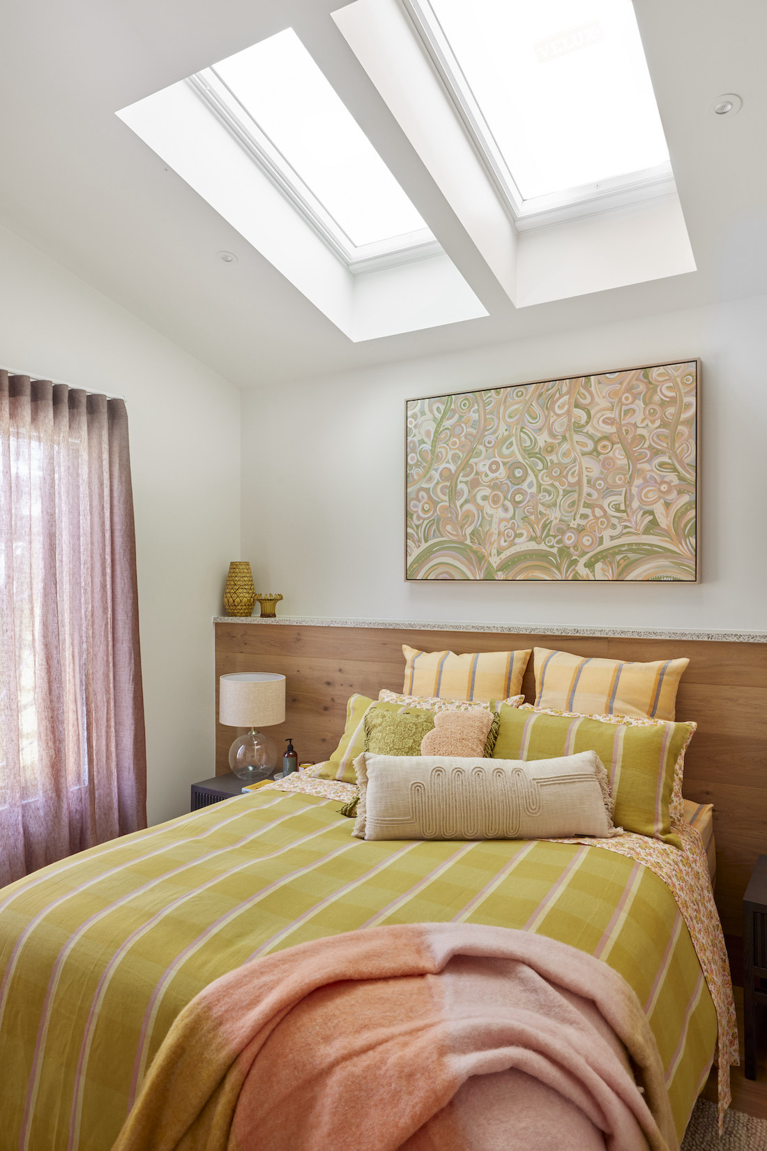 Guest bedroom with abstract art and green bedding