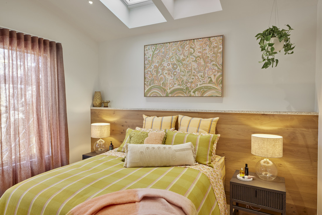 Guest bedroom in green and blush tones