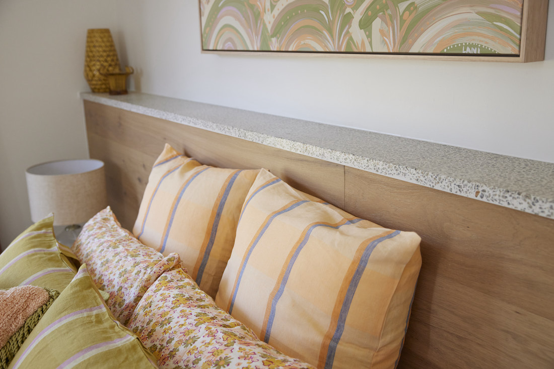Apricot striped cushions with floral and terrazzo