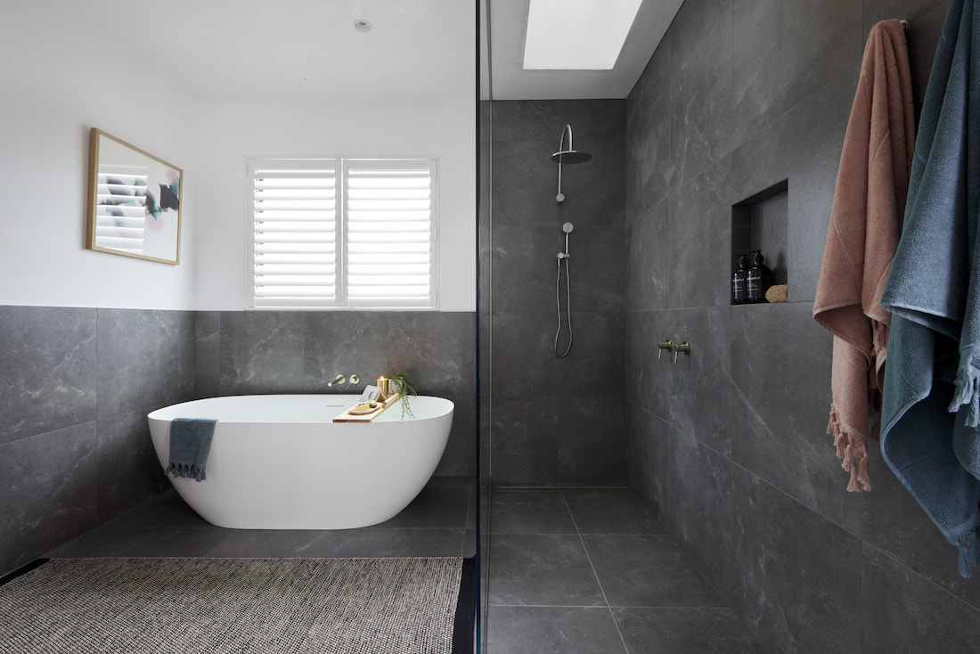 Dark bathroom with freestanding bath