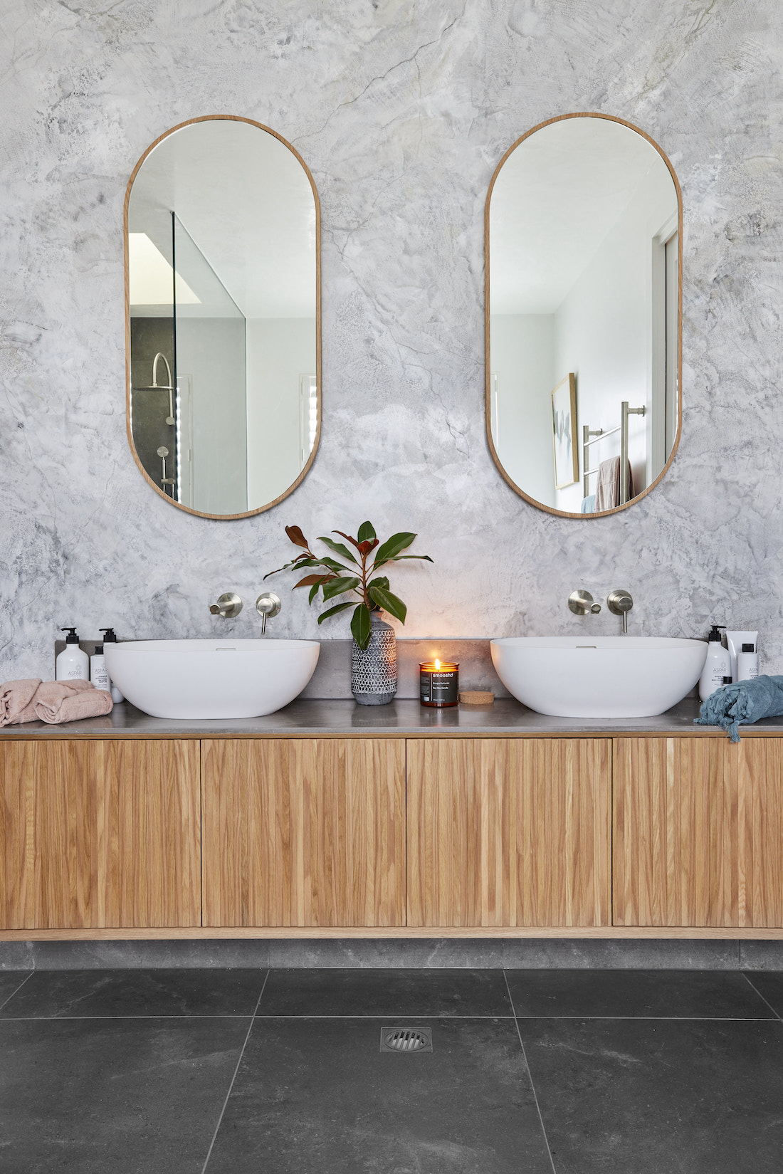 Timber vanity with pill shaped mirrors