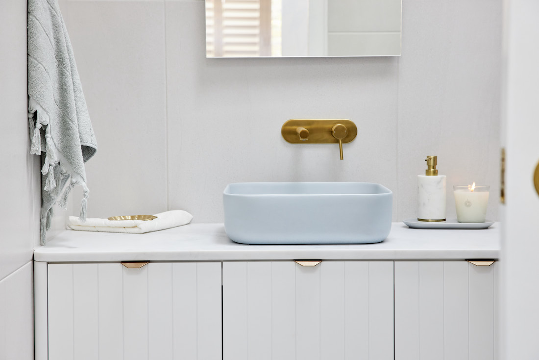 Blue rectangular sink in white bathroom