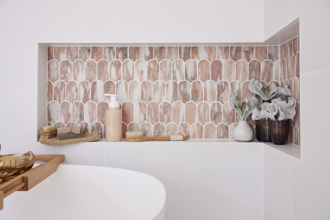 Shower niche with pink marble tiles