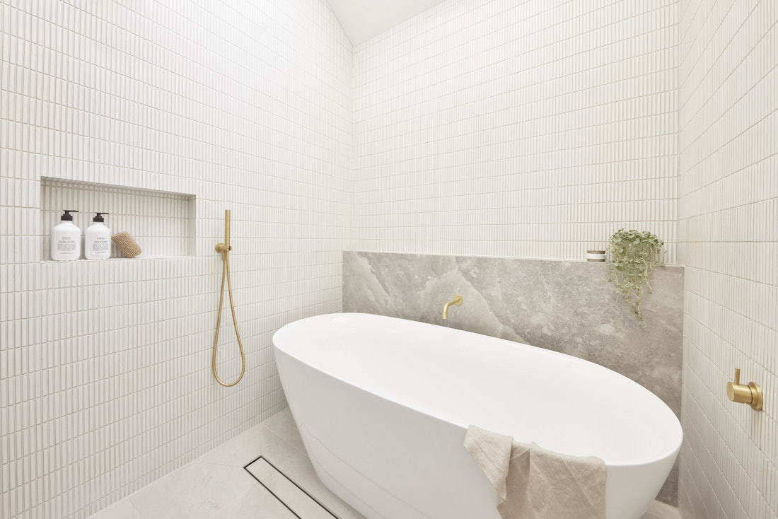 Guest bathroom with white kit kat tile and freestanding bath