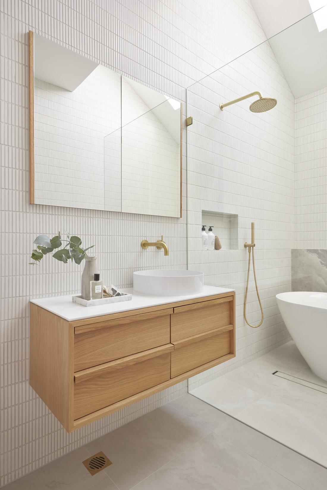 Floating timber vanity in white bathroom