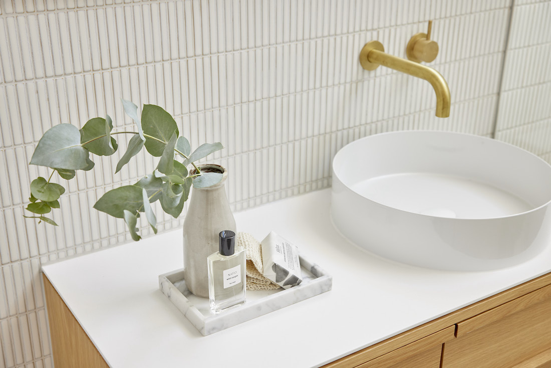 Bathroom vanity styling with tray and white kit kat tiles