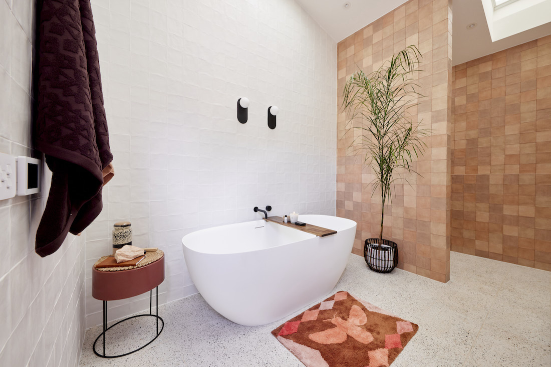 Freestanding bath with brown feature wall