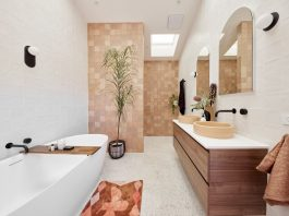 Moroccan feel bathroom with timber vanity and brown mosaic feature wall