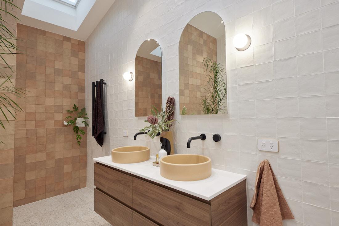 Double vanity with beige concrete sinks