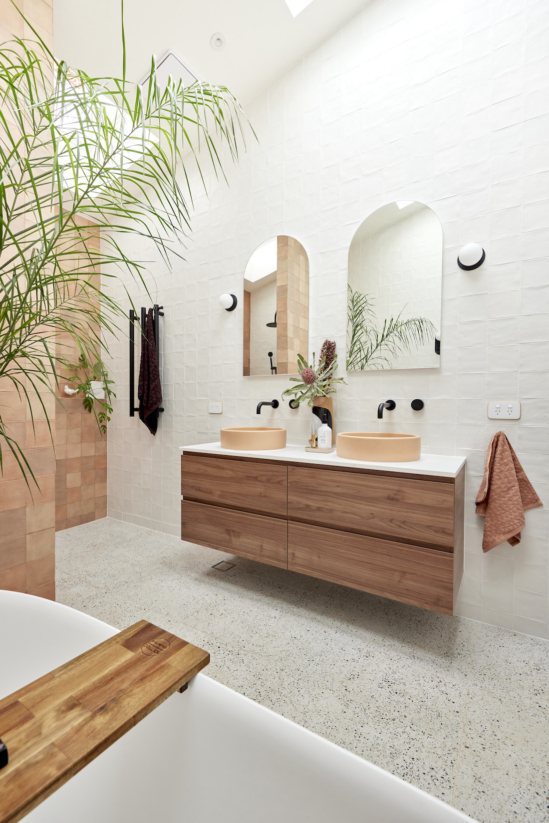 Timber floating vanity with arch mirrors
