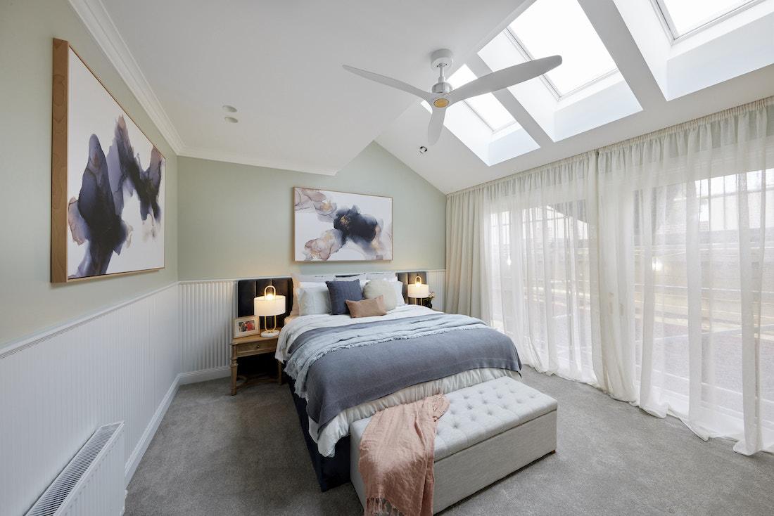 Master bedroom in soft green tones