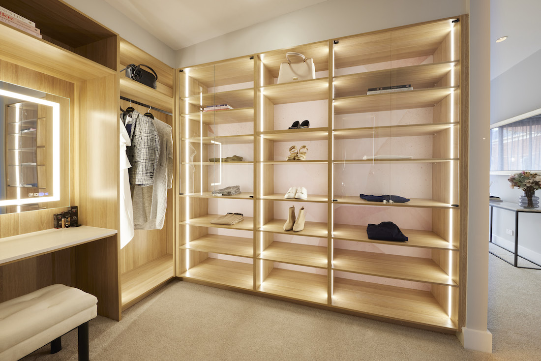 Master walk-in wardrobe with back lit shelving