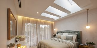 Sophisticated bedroom with mood lighting and skylights