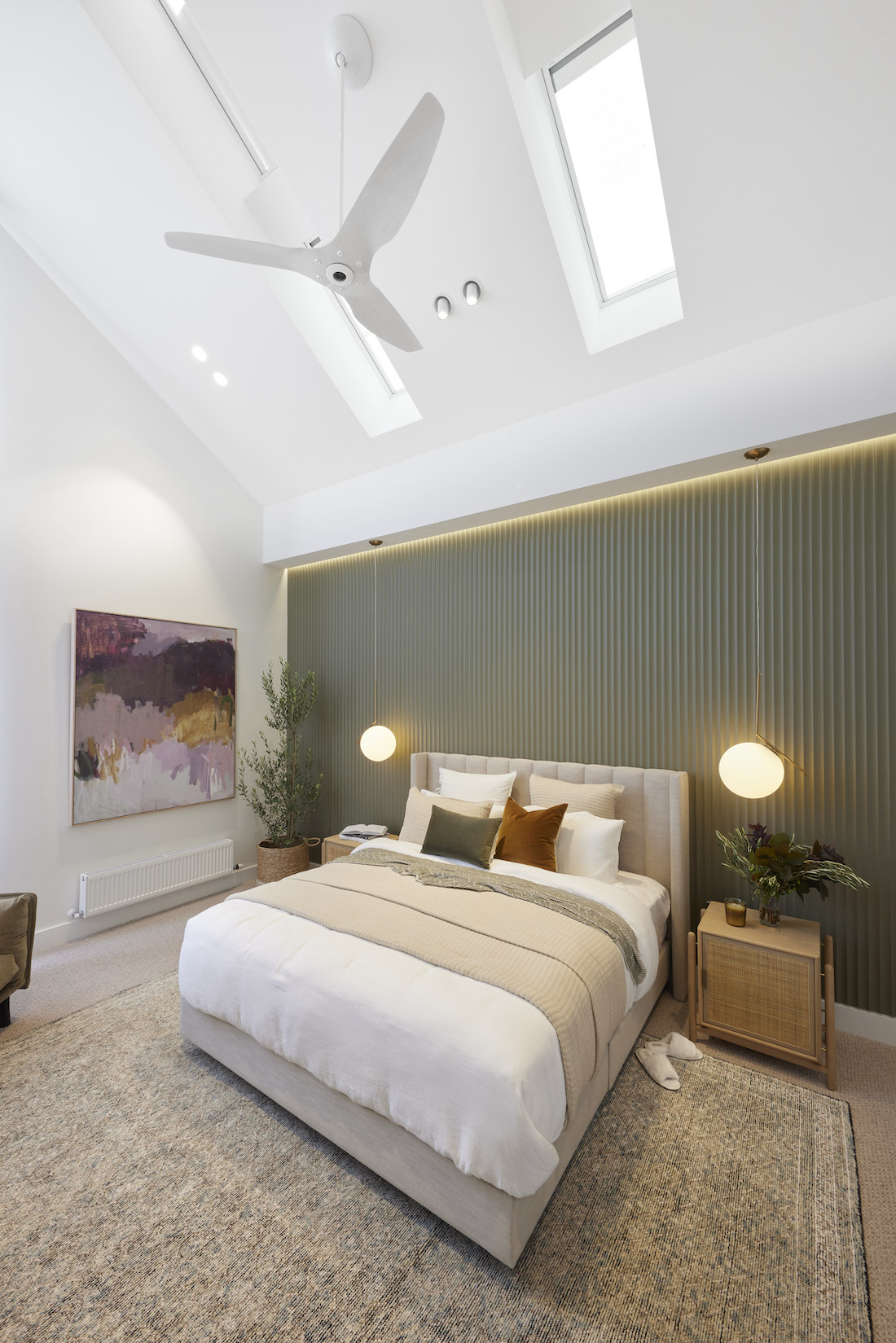 Sage green fluted feature wall with skylights in cathedral ceiling