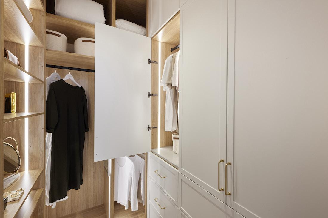 Walk in wardrobe in master bedroom showing storage