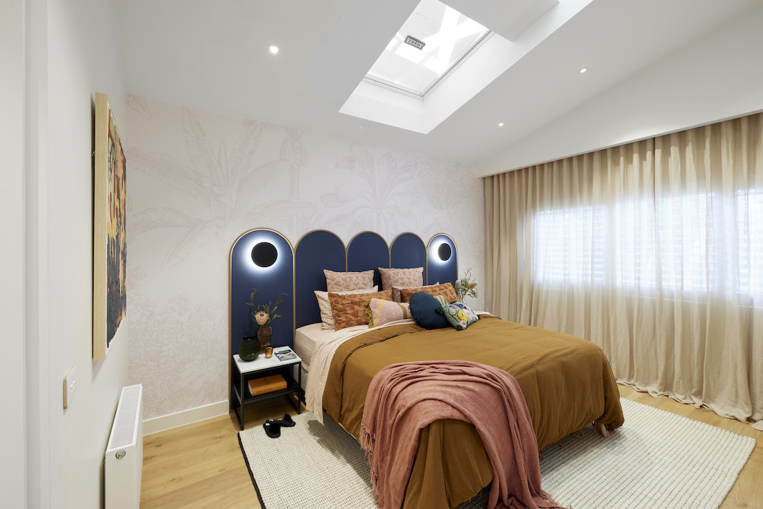 Master bedroom in tan and navy