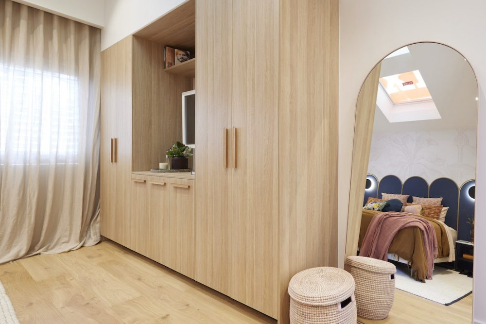 Built in timber wardrobe with arch mirror