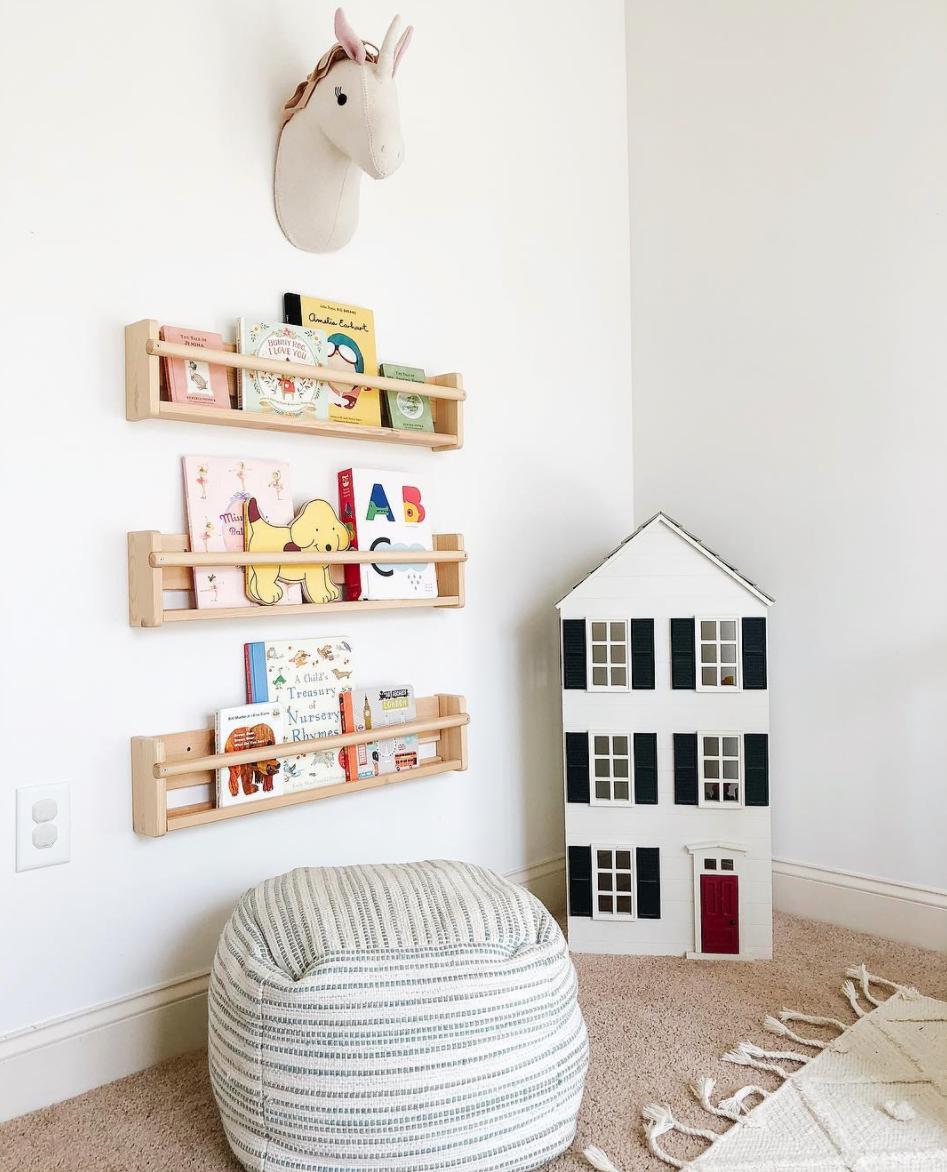 Timber bookshelves in kids reading nook