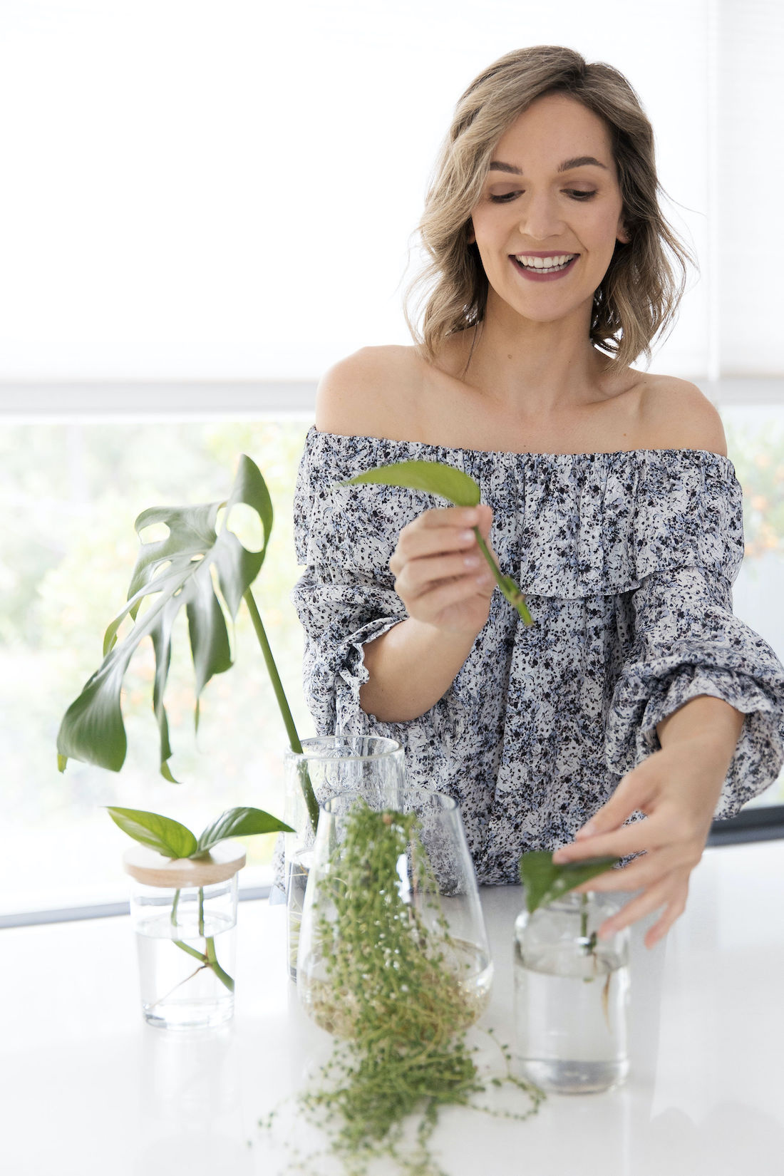 Gina growing plants in water