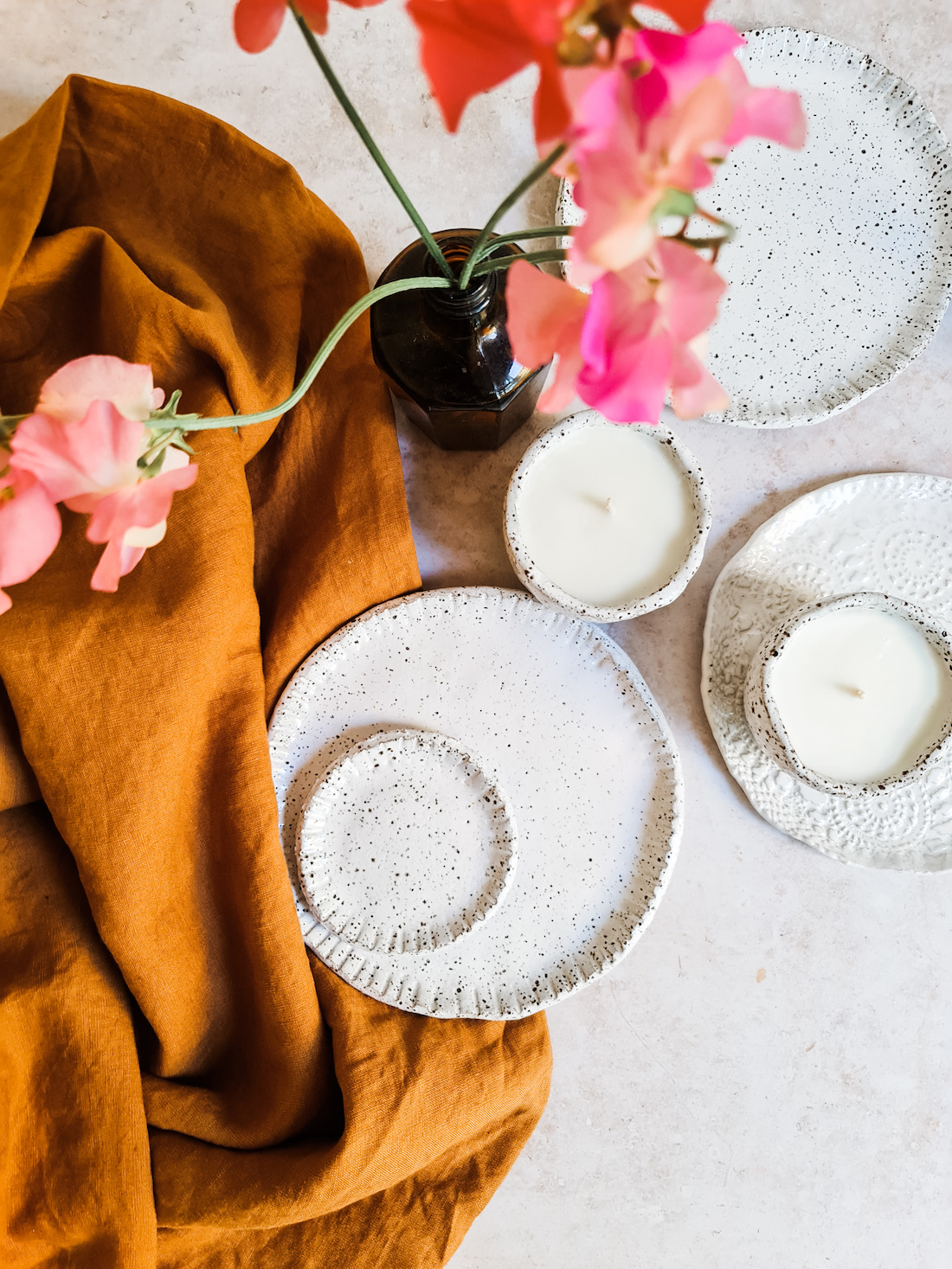 The Seasonal Ceramicist_plates and candles_imperfect textural designs