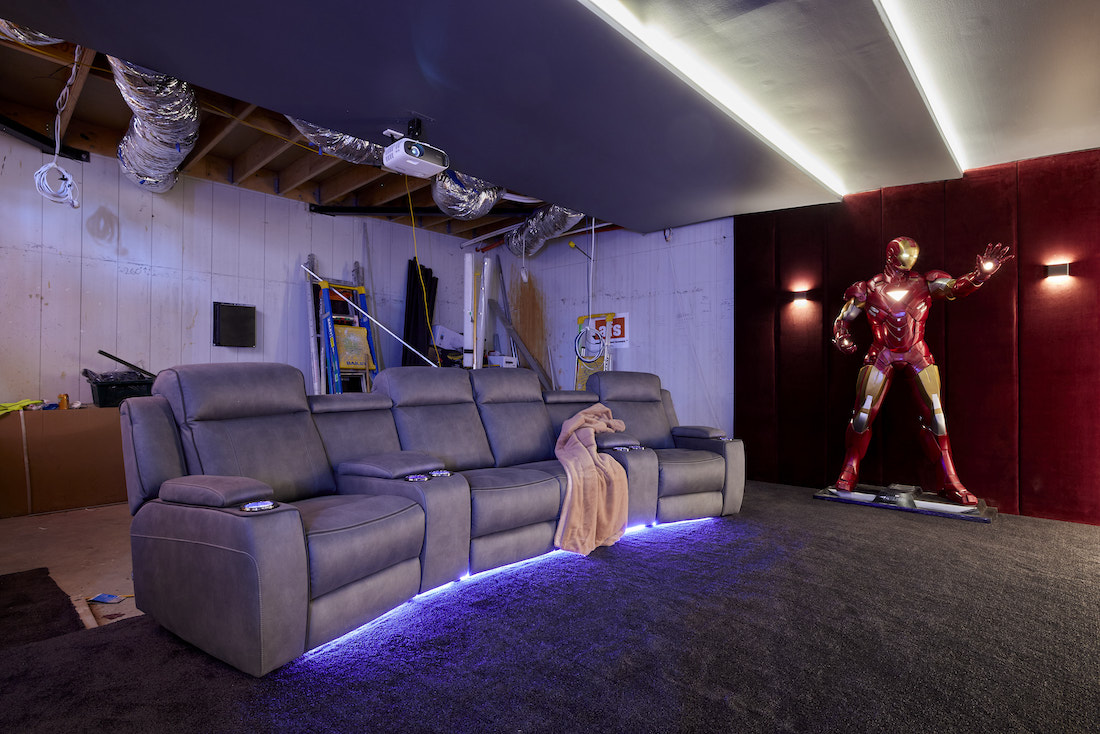 Life-sized Ironman sculpture in unfinished home cinema