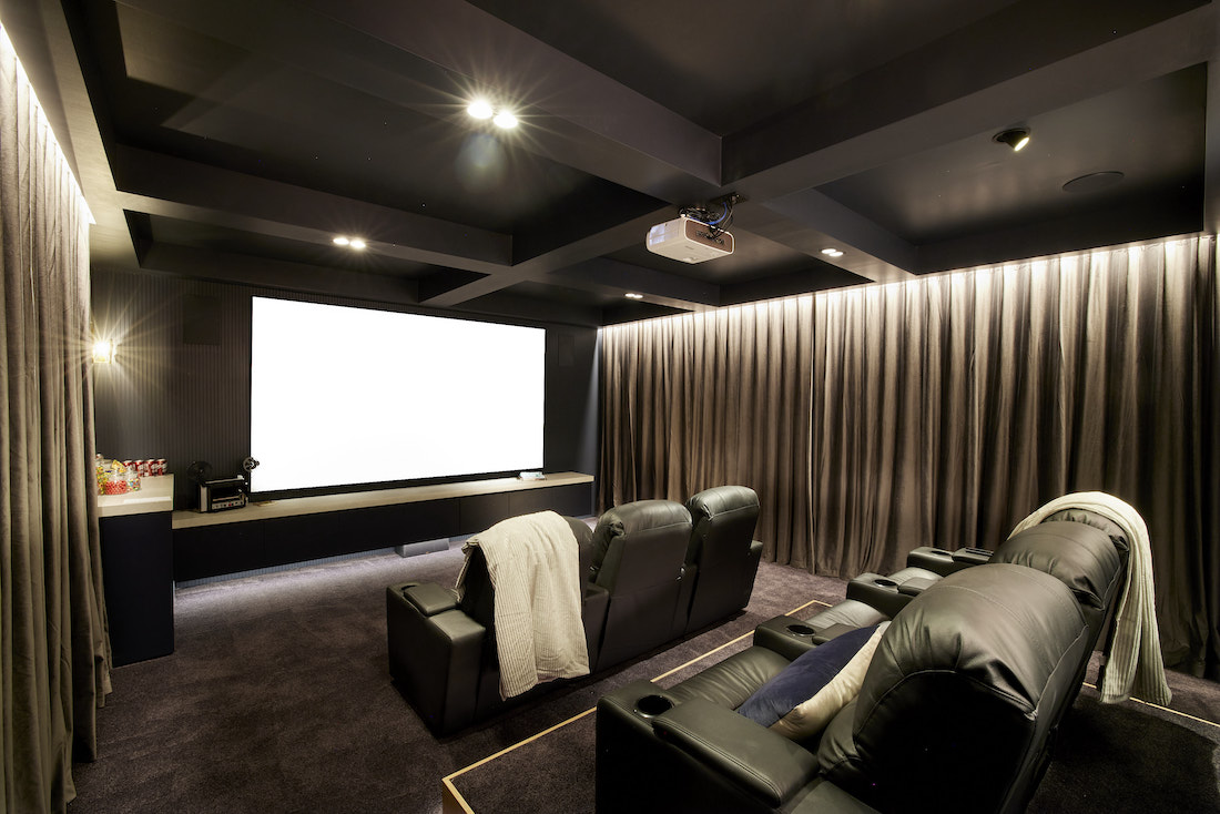 At home cinema with unique ceiling