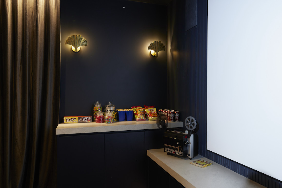 Snack set up and vintage projector in at home cinema